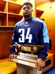 Nashville Christian's Brant Lawless, stands with his Mr. Football trophy at Nissan Stadium, Monday, Nov. 27, 2017, in Nashville, Tenn.  (Photo by Wade Payne, Special to the Tennessean)
