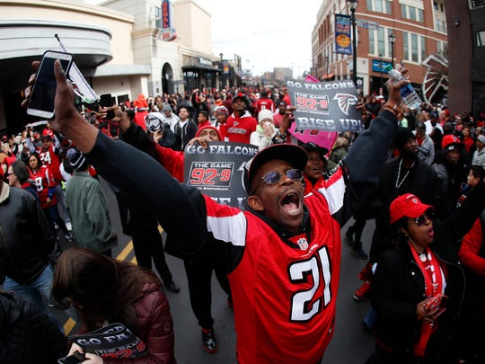 Fans cheer during a send off pep rally for the Atlanta Falcons football team as they make their way to the airport for a flight to Houston and Super Bowl 51 to Sunday, Jan. 29, 2017, in Atlanta.