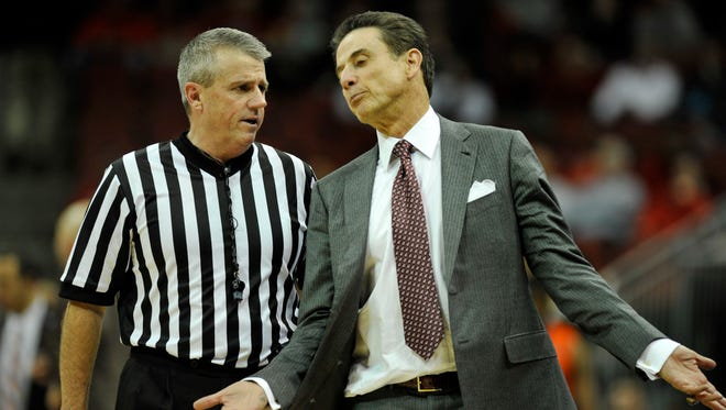 Louisville coach Rick Pitino discusses a call with an official during the Clemson game.  Jan. 7, 2015.