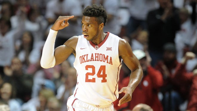 Oklahoma Sooners guard Buddy Hield (24) reacts after a play against the Baylor Bears during the first halt at Lloyd Noble Center.