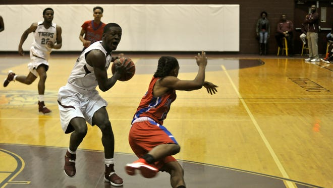 Pensacola High's Robert Reaves drives the paint against Pine Forest on Friday night.
