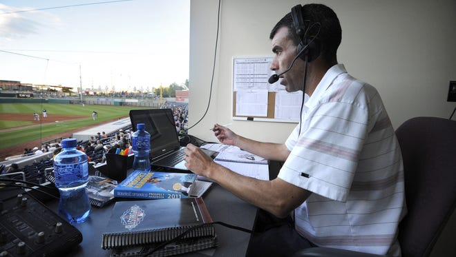 Ryan Radtke works an Aces game from his booth behind home plate during the 2011 season. Radtke has signed a deal with Westwood One.