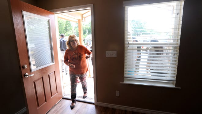 Margaret Nieto enters her new home in the 1100 block of Pecan Street Wednesday May 31, 2017. Her previous house was 92 years old, it was torn down and a new one built in its place thanks to a federal grant administered through Abilene's Office of Neighborhood Services.