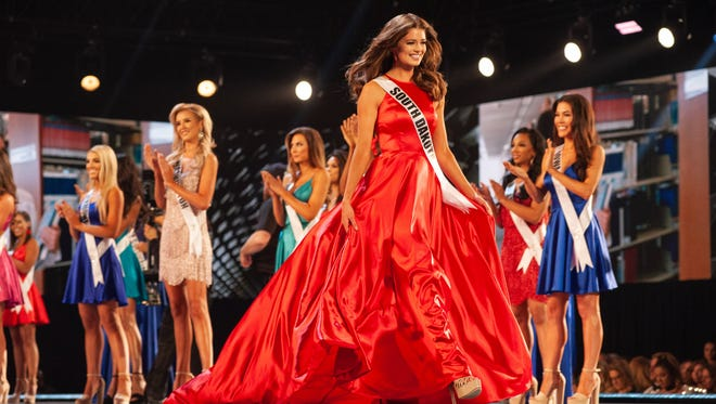 Madison Nipe, Miss South Dakota, is announced as a top 15 finalist in fashion  during the Miss USA competition.