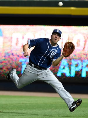 San Diego Padres right fielder Jeff Francoeur (15) makes a running catch on a ball hit by Atlanta Braves third baseman Chris Johnson (not shown) during the seventh inning July 25 at Turner Field. Credit: Dale Zanine-USA TODAY Sports
