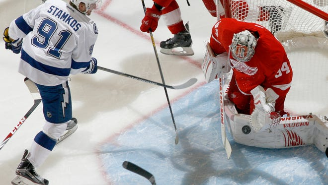 Red Wings goalie Petr Mrazek blocks a shot in front of Tampa Bay's Steven Stamkos in the first period of Tuesday's game at Joe Louis Arena.