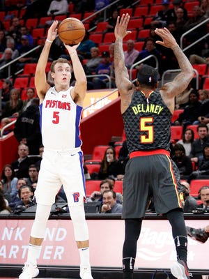 Pistons guard Luke Kennard (5) attempts a shot against Hawks guard Malcolm Delaney (5) during the second quarter on Friday, Nov. 10, 2017, at Little Caesars Arena.