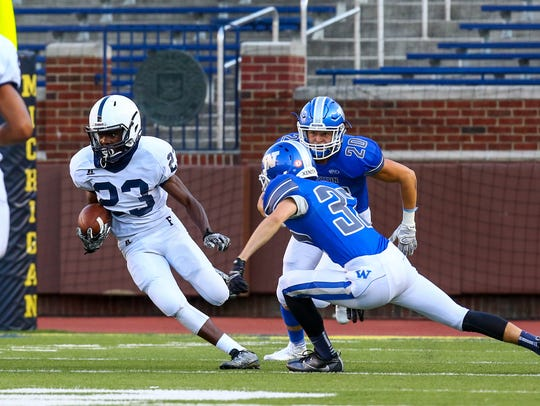 Sophomore Kendall Williams returns a kickoff as a pair