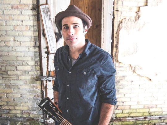 Joshua Davis performs Sunday at Congregation Tikkun V'Or.