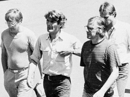 In this March 11, 1982 photo, from left, Jan Cornelius Kuiper, director, Koos Koster, producer, Johannes Willemsen, cameraman, and Hans ter Laan, soundman walk north of the capital, San Salvador, days before they were killed in El Salvador. Calls are mounting for Col. Mario Reyes Mena, a former Salvadoran army colonel, to be brought to justice for the killings.