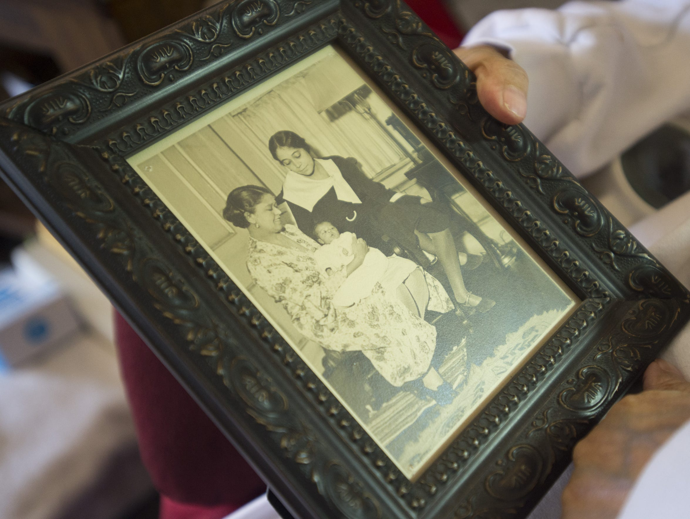 """Yolande """"Du Bois"""" Irvin shows off a photo of her and"""