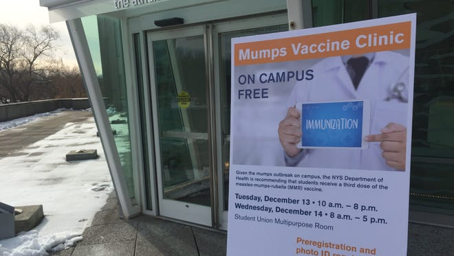 A sign for a mumps vaccine clinic sits outside of SUNY New Paltz's Student Union Building, where the health initiative was being held.
