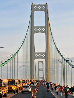 Walkers head south during the 59th annual Mackinac Bridge Walk on Monday, Sept. 5, 2016.