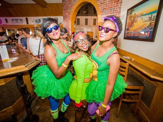 Three '90s Bar Crawl participants dressed up as Teenage