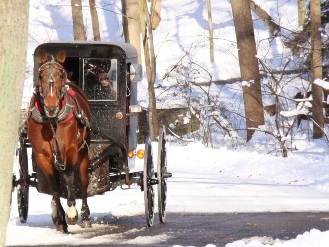 With horse-drawn buggies clomping along country roads,