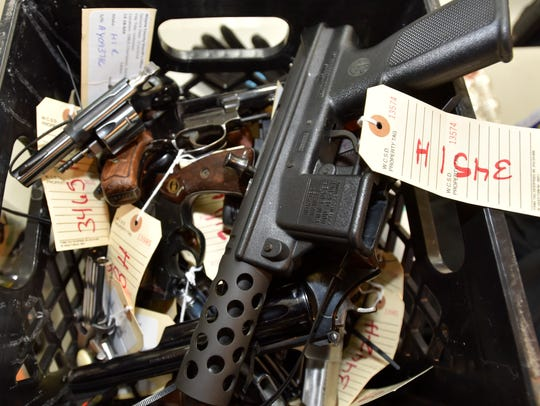 A box of handguns turned in during the buy back program,