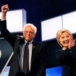 Sen. Bernie Sanders, I-Vt., and Hillary Clinton before the start of the Democratic presidential debate.