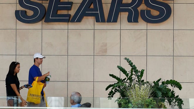Sears and several other retailers scored a low rating from Moody?s.   Gene J. Puskar/AP File photo taken in 2017 shows shoppers walking by a Sears sign at a store in Pittsburgh, Pa.