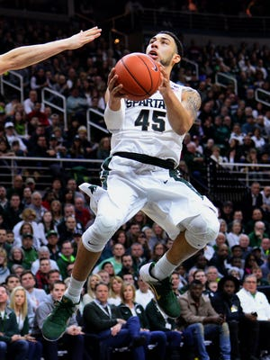 Spartans guard Denzel Valentine (45) goes up for a shot in the first half against Indiana Sunday, Feb. 14, 2016 in the Breslin Center in East Lansing.