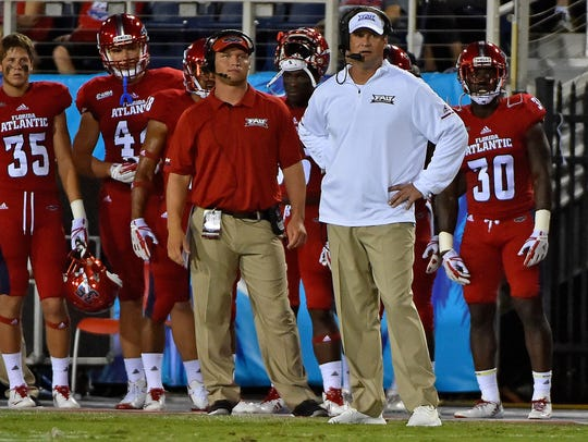 Florida Atlantic head coach Lane Kiffin looks on from