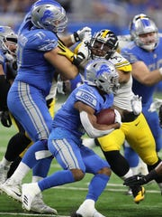 Ameer Abdullah runs as Lions OL Rick Wagner blocks Steelers DL Mike Hilton during the first quarter Sunday, Oct. 29, 2017 at Ford Field.