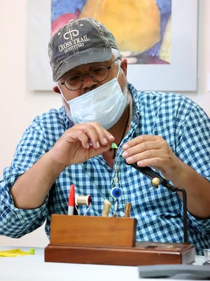 Duane Hada of Yellville, leads a class in fly tying, Saturday, June 6, 2020, at the Van Buren Center for Art & Education during his Small Mouth Bass Fly Fishing Workshop.