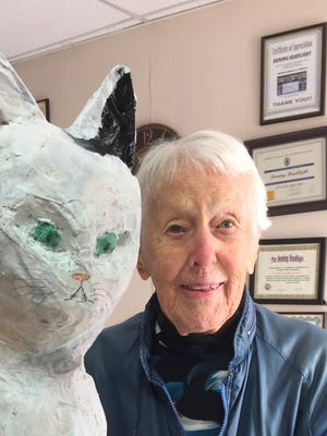Barbara Miller, soon to be 94, visited the Deming Headlight office on Wednesday, Jan. 3, with her new companion Lady Mache. Miller, a retired high-end jewelry designer and artist, made the nearly three-foot cat out of recycled Deming Headlight newspapers.
