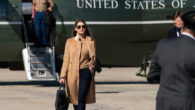 Counselor to the President Hope Hicks walks from Marine One to accompany President Donald Trump aboard Air Force One as he departs Wednesday at Andrews Air Force Base, Md.
