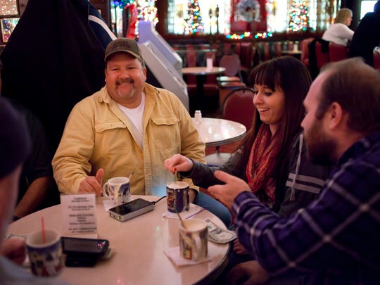 Troy Aldea, Rachel Kelly and Sean Richardson, all of Port Huron, have Tom and Jerrys together at the Brass Rail in downtown Port Huron.