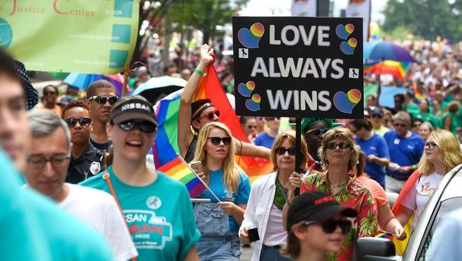The LGBT community parades along Nashville streets during the Equality Walk and Nashville Pride Festival.  Saturday June 25, 2016, in Nashville, Tenn.