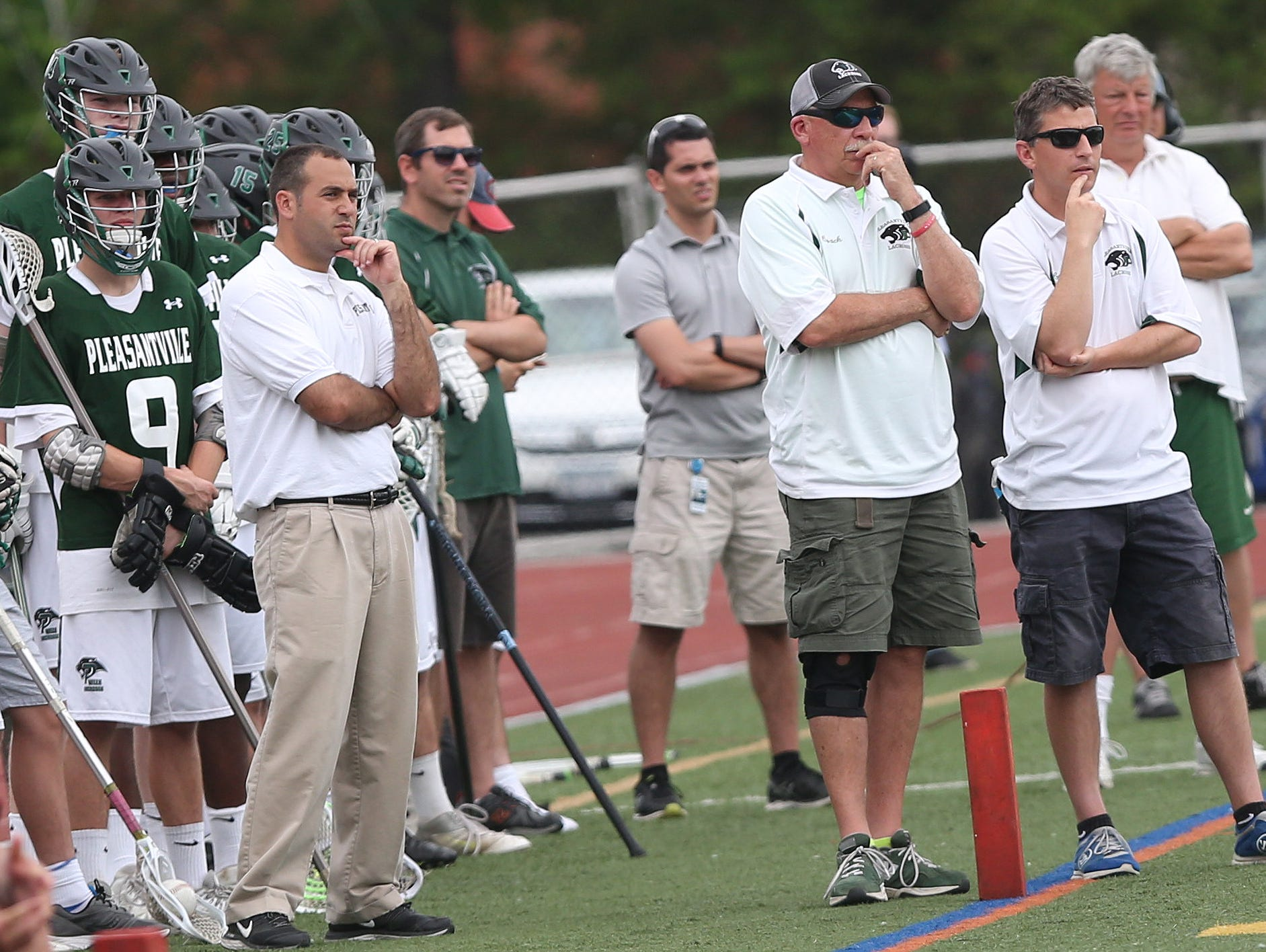 Pleasantville coach Chris Kear (right) watches as the Panthers defeated Rondout Valley in the state Class C regional lacrosse championship game at Dietz Stadium in Kingston June 4, 2016.