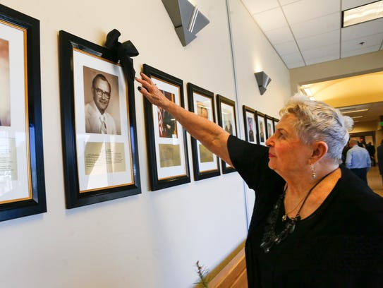 Joyce Brown examines at a portrait of her late husband Judge James Brown during a ceremony on Tuesday at Aztec District Court.