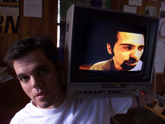 - In this 1999 photo, filmmaker Lance Weiler holds