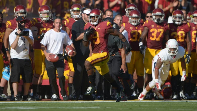 Southern California Trojans receiver JuJu Smith speeds down the sideline on a 53-yard reception.