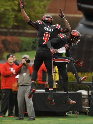 U of L's DeVonte Parker celebrates in the endzone after a touchdown in the second half.  Nov. 29, 2014