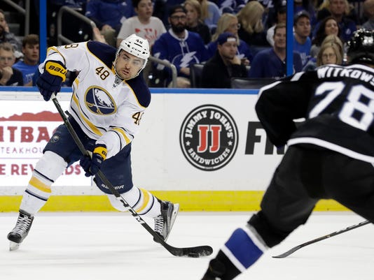 Buffalo Sabres left wing William Carrier (48) shoots the puck past Tampa Bay Lightning defenseman Luke Witkowski (28) and goalie Andrei Vasilevskiy (not shown) for a goal during the first period of an NHL hockey game Sunday, April 9, 2017, in Tampa, Fla. (AP Photo/Chris O'Meara)