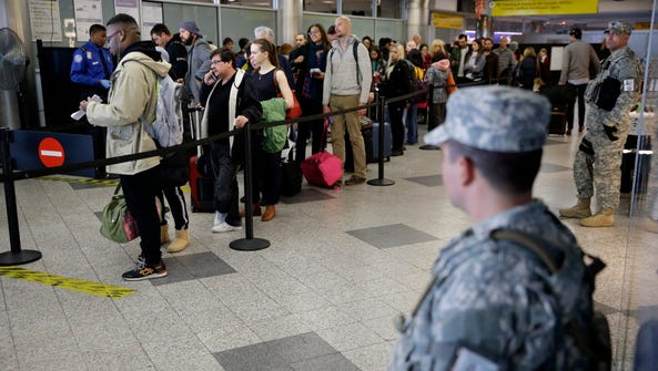 Fliers at LaGuardia Airport in New York on Wednesday.