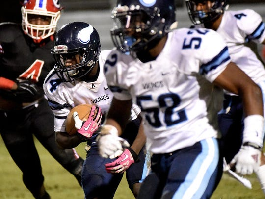 Airline's Coby McGee runs with the ball during a game