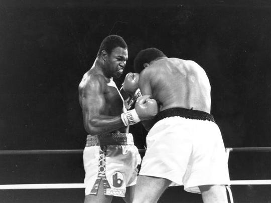 World heavyweight champion Larry Holmes, left, pounds challenger Muhammad Ali in the corner during championship fight in Las Vegas, Nev., Thursday night, Oct. 2, 1980. Holmes won when Ali failed to answer the bell to start the 11th round.