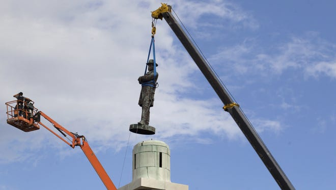 A statue of Confederate General Robert E. Lee is removed from Lee Circle in New Orleans on May 19.