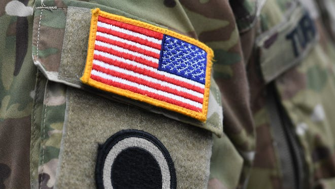 A U.S. flag is pictured on a soldier's uniform during the 'Dynamic Front 18' exercise in Grafenwoehr, near Eschenbach, southern Germany, on March 7, 2018.