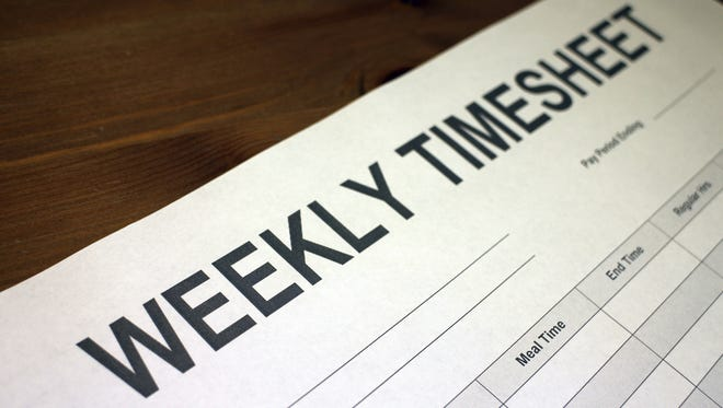 Hourly workers are required to fill out timesheets; exempted workers are not.