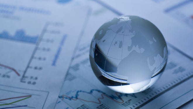 Glass globe on  stock market chart . shot with very shallow depth of field.blue tone