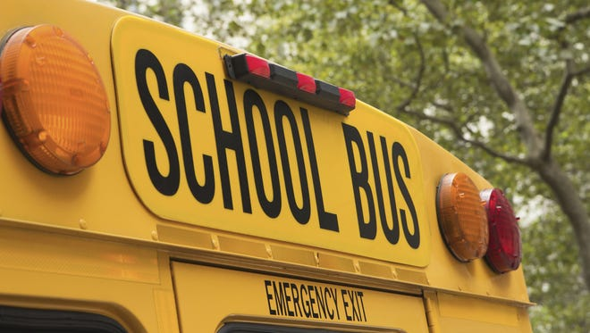 Jaroslav Frank,  Getty Images/iStockphoto Back of school bus with a sign. Generic image fem think stock.