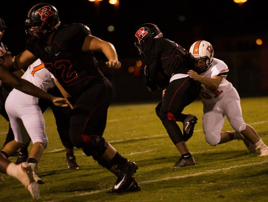 Rossview's Fred Orr, 2, tries to break through a tackle