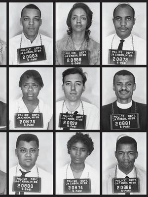 """Mug shots of John Lewis (bottom right corner) and other Freedom Riders arrested on May 24, 1961, after arriving from Montgomery, Alabama. Police arrested them after they entered a """"whites-only"""" area in the Jackson bus station and refused to move on."""