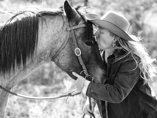 Shanen Ebersole nuzzles her horse, Pete's Sake, on