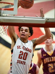 St. Cloud State's Gage Davis goes in to score against the University of Minnesota-Duluth during the first half Tuesday, Jan. 17 at Halenbeck Hall.