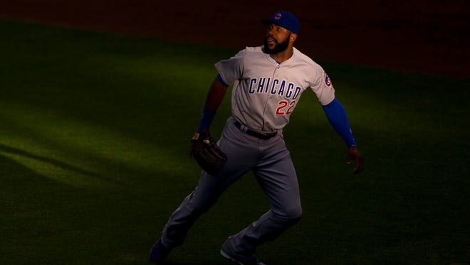 Chicago Cubs right fielder Jason Heyward (22) chases a fly ball during the first inning against the Milwaukee Brewers at Miller Park.