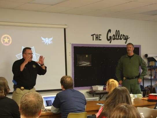Sgt. Chris Olson and investigator Jeff Morlock with
